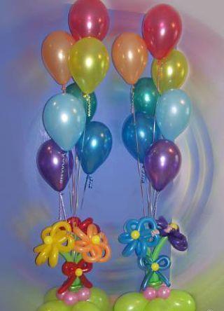 Букет из воздушных шаров с цветами и гелевыми шариками